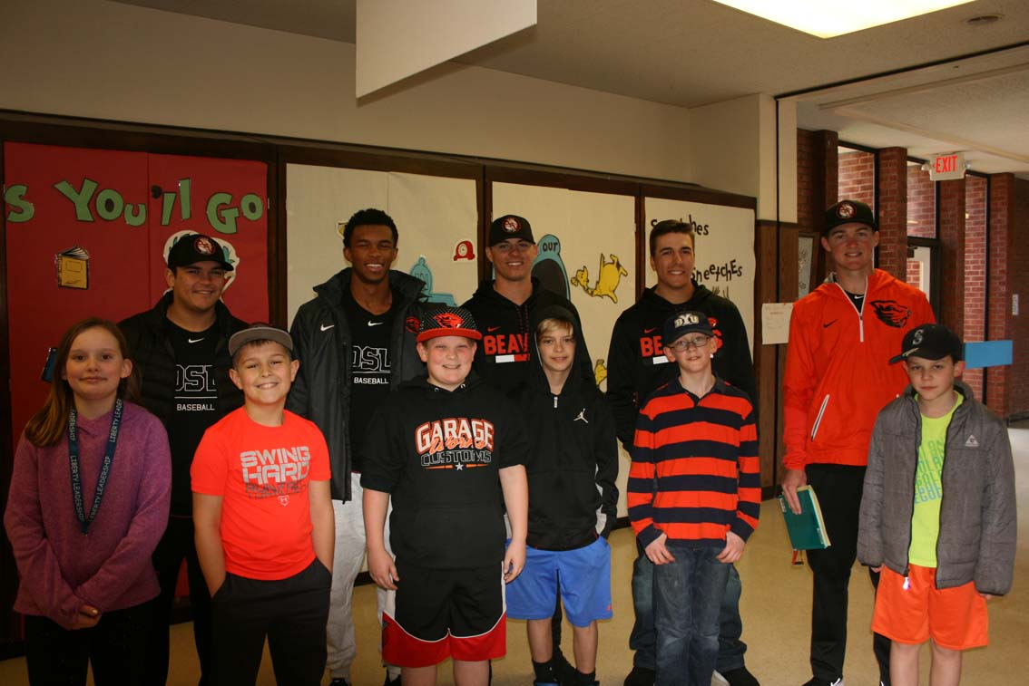 OSU student athletes with elementary students.