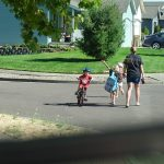 children walking home with mom after school